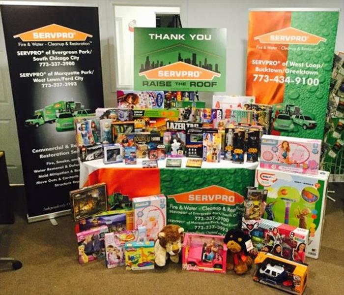 SERVPRO banners and table with toys on and around the table