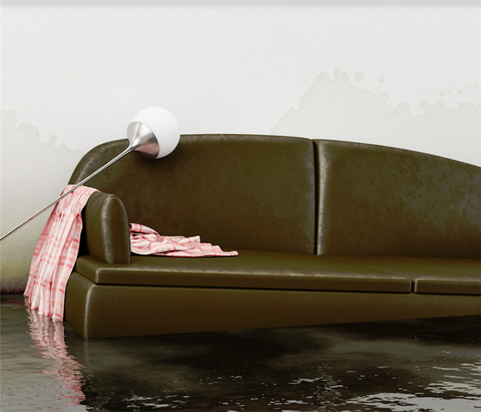 a flooded living room with a floating couch