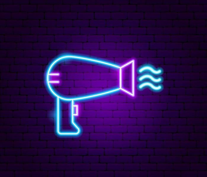neon image of hair dryer, purple brick background
