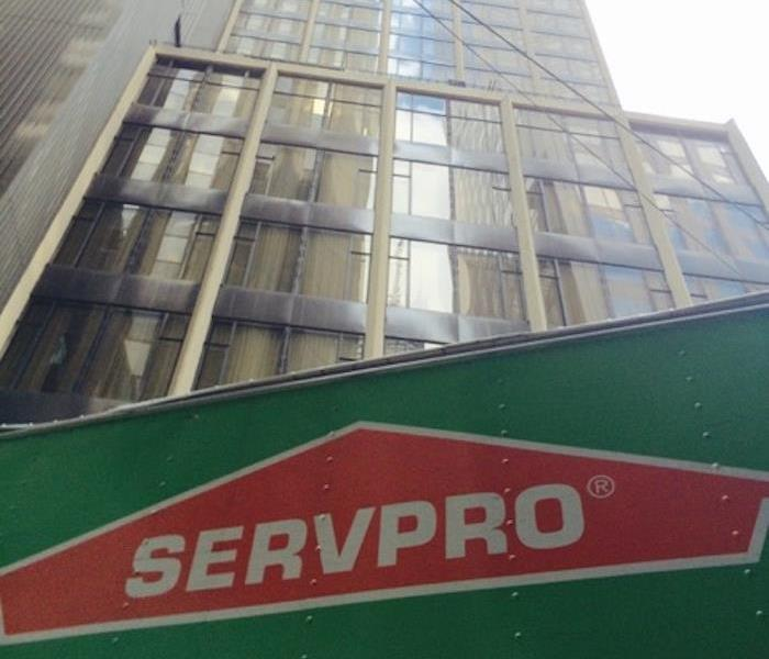 looking up at a tall building and SERVPRO 18 wheeler